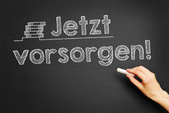 Jetzt vorsorgen! (Take precaution now!). Hand writes in German Jetzt vorsorgen! (Take precaution now!) on blackboard Royalty Free Stock Image