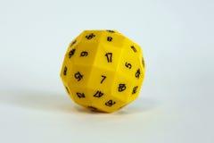 Jeu aléatoire de jouet de matrices de jeu jaune de nombre photographie stock