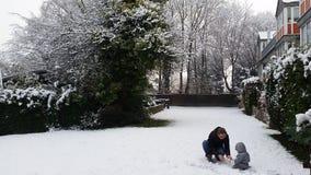 Jeu dans la neige Photos stock