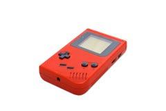 jeu de console tenu dans la main Image stock