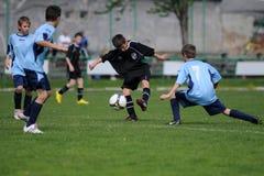 Jeu de football U13 Photos libres de droits
