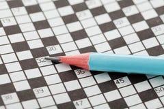 Jeu de mots croisé et crayon de plan rapproché Photo libre de droits