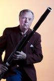 jeu de musicien d'isolement par bassoon image stock