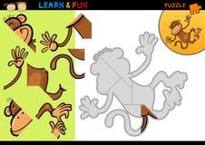 Jeu de puzzle de singe de dessin animé Photographie stock