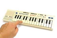 Jeu du vieux piano électrique Photo libre de droits