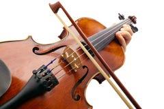 Jeu du violon sur le backround blanc Photos libres de droits