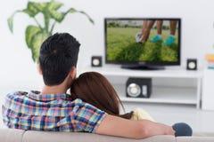 Jeu à la TV Photographie stock libre de droits