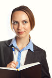 Jeune écriture de femme d'affaires dans son organisateur Image libre de droits