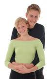 Jeune étreindre heureux de couples Photographie stock libre de droits