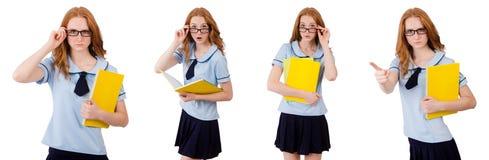 Jeune étudiant avec des carnets d'isolement sur le blanc Image libre de droits