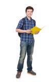 Jeune étudiant With Book Photographie stock libre de droits