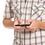 Jeune étudiant rectifié occasionnel Texting sur le téléphone portable photos stock