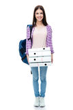 Jeune étudiante heureuse avec le sac à dos et les dossiers Image stock