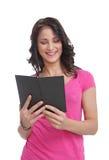 Jeune adolescent affichant un livre Photos stock