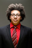 Jeune adolescent confiant avec Afro Photographie stock libre de droits