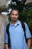 Jeune adulte mâle avec le sac à dos Images libres de droits