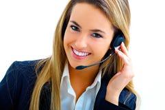 Jeune aide sur le centre d'attention téléphonique Photos stock