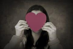 Jeune amour caché Images stock