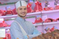 Jeune apprenti de boucher de portrait photo libre de droits