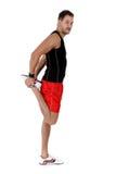 Jeune athlète caucasien d'homme, patte fléchie photo stock