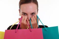 Jeune beau femme avec des sacs à provisions Photo stock