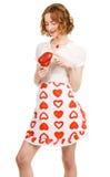 Jeune beau femme retenant un paprika Photographie stock libre de droits