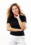 Jeune beau femme sexy avec la pomme rouge sur le blanc Images libres de droits