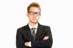 Jeune, bel homme d'affaires portant le costume noir Photographie stock