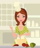 Jeune belle cuisson de femme Photographie stock