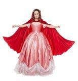 Jeune belle femme dans la longue robe médiévale et l'isola rouge de manteau Images stock
