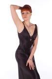 Jeune belle femme dans une robe pour des cocktails Photographie stock