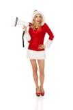 Jeune belle femme de Santa tenant le mégaphone Images stock