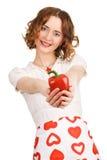Jeune belle femme donnant un paprika Images stock