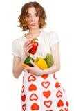 Jeune belle femme donnant un paprika Photo stock