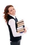 Jeune belle fille d'étudiant avec des livres à disposition Image stock