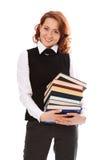 Jeune belle fille d'étudiant avec des livres à disposition Images stock