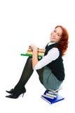 Jeune belle fille d'étudiant avec des livres à disposition Photos stock