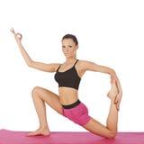 Jeune belle pose de yoga de fille Photographie stock libre de droits