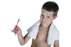Jeune brosse à dents de fixation de garçon, projectile de studio Photographie stock libre de droits