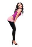 Jeune brunette espiègle sexy dans guêtres noires Images stock