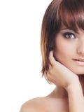 Jeune brunette sexy d'isolement au-dessus du fond blanc Photos libres de droits