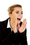 Jeune buisnesswoman heureux criant image stock