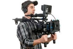 Jeune cameraman avec l'appareil-photo de film Photos stock