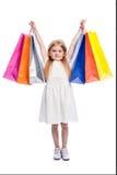 Jeune client enthousiaste avec de grands paniers colorés Photographie stock libre de droits