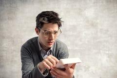 Jeune comptable perplexe Photo stock
