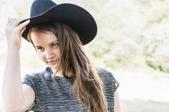 Jeune cow-girl Photographie stock libre de droits
