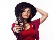 Jeune cow-girl tenant l'arme à feu Image stock