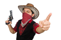 Jeune cowboy avec l'arme d'isolement sur le blanc Photographie stock libre de droits