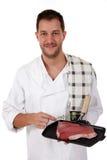 Jeune cuisinier mâle caucasien attirant, bifteck à l'os images stock