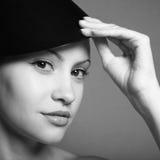 Jeune dame avec le chapeau Photographie stock